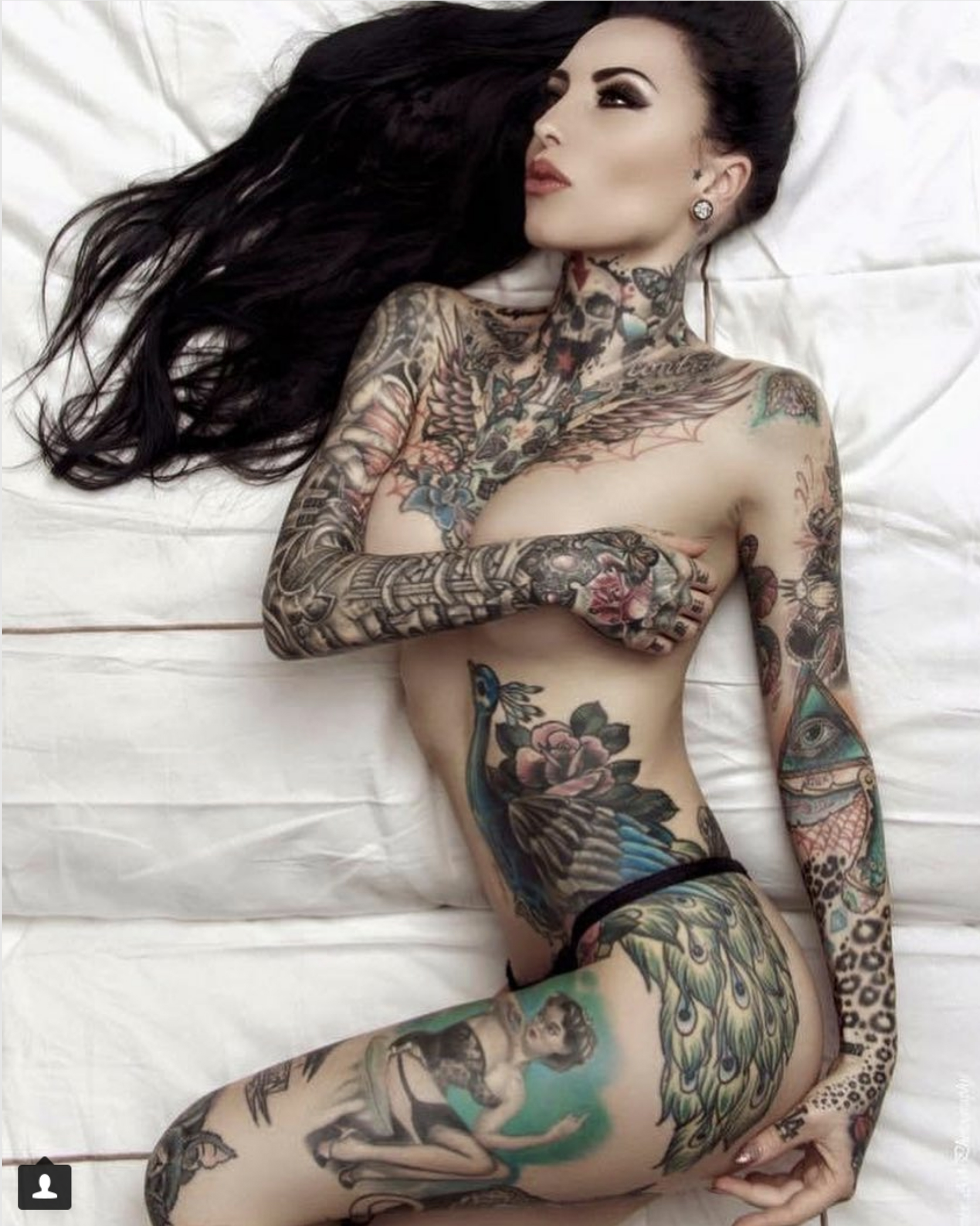 This Beautiful Tattoo Model Gets a Tattoo With The DNA of Her Cat